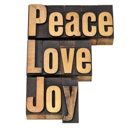 peace, love and joy - isolated words in vintage letterpress wood type Stock Photo - 12358987