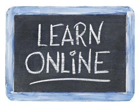 learn online sign - white chalk handwriting on a small retro slate blackboard Stock Photo - 12358999
