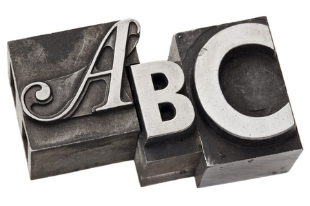 printing block: abc - first three alphabet letters in vintage letterpress metal type, isolated on white Stock Photo
