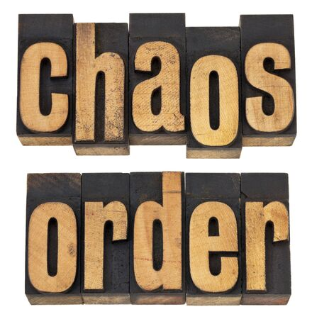 chaos order: chaos and order  - a collage of isolated words in vintage letterpress wood type