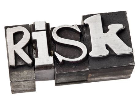 risk - isolated word in vintage letterpress metal type Stock Photo - 12674674