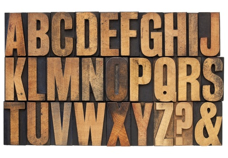letterpress words: 26 letters of English alphabet, question mark and ampersand - antique letterpress wood type printing blocks with ink patina