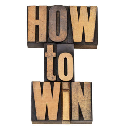 printing block block: how to win advice - isolated phrase in vintage letterpress wood type
