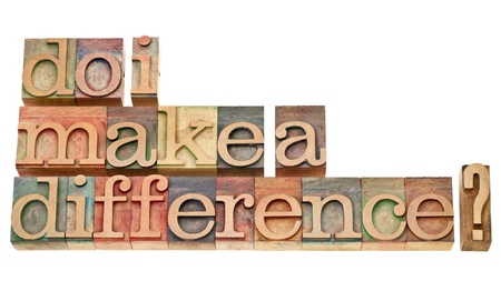 Do I make a difference? A question in vintage wooden letterpress printing blocks isolated on white. Stock Photo - 12674697