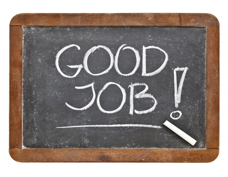 Good job compliment - white chalk handwriting on retro slate blackboard Stock Photo - 12674700