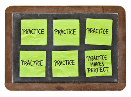 practice makes perfect concept - green sticky notes with black handwriting on a vintage slate blackboard Stock Photo - 12674698