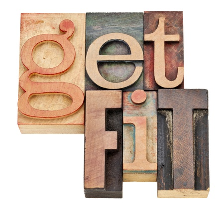 fitness motivation: get fit - motivation concept  - isolated words in vintage letterpress wood type