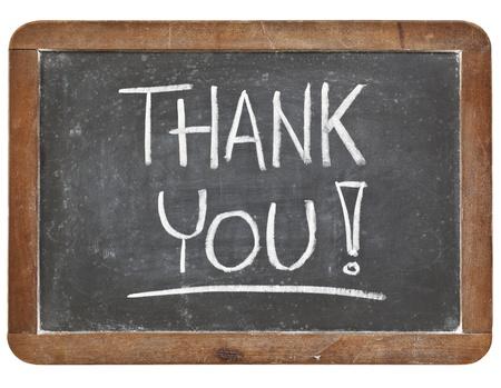 dank je wel - wit krijt handschrift op vintage leisteen schoolbord geïsoleerd op wit Stockfoto