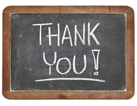 thank you - white chalk handwriting on vintage slate blackboard isolated on white photo