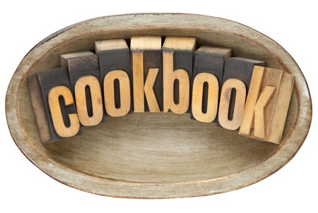 cookbook - word in vintage letterpress type in wooden dough bowl Stock Photo - 12871288