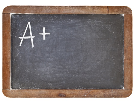 A plus grade - white chalk handwriting on retro slate blackboard, isolated on white Stock Photo - 12871304