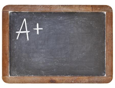 blank slate: A plus grade - white chalk handwriting on retro slate blackboard, isolated on white