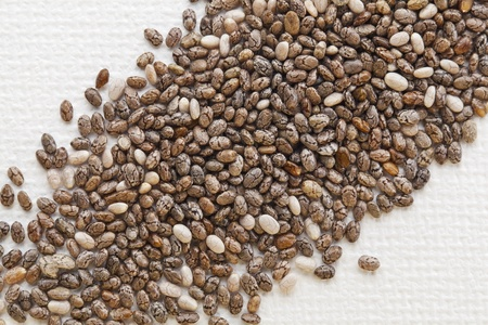 organic chia seeds rich in omega-3 fatty acids, diagonal composition on white artist canvas photo