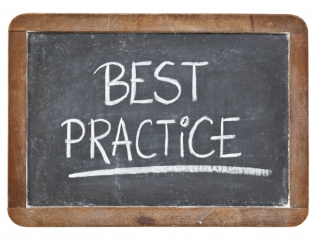 best practice - white chalk handwriting on isolated vintage slate blackboard photo