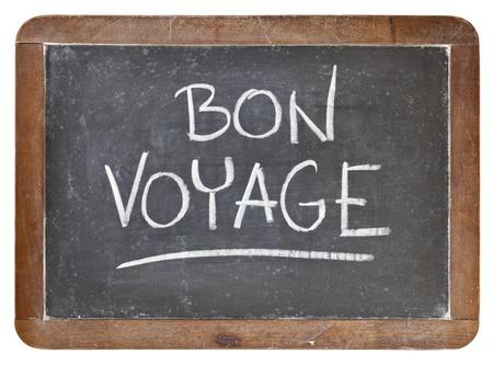 the farewell: Bon Voyage - concepto de viajes o de despedida - letra de tiza blanca sobre pizarra, pizarra de la vendimia aislado