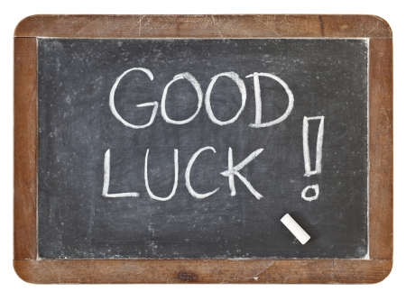 good luck: good luck - white chalk handwriting on isolated vintage slate blackboard