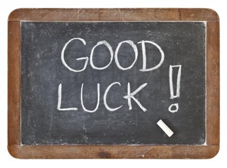 good luck - wit krijt handschrift op geïsoleerde vintage lei schoolbord Stockfoto