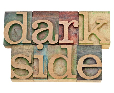 dark side - moral concept - isolated text in vintage letterpress wood type Stock Photo - 12871497
