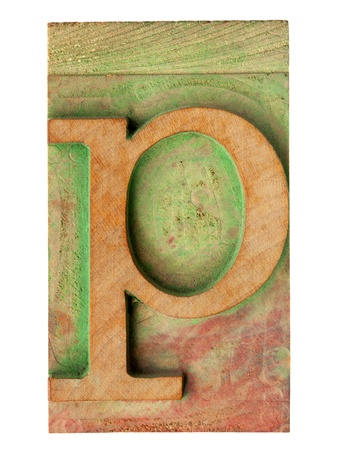 isolated letter p in vintage letterpress wood type stained by color ink Stock Photo - 12871499