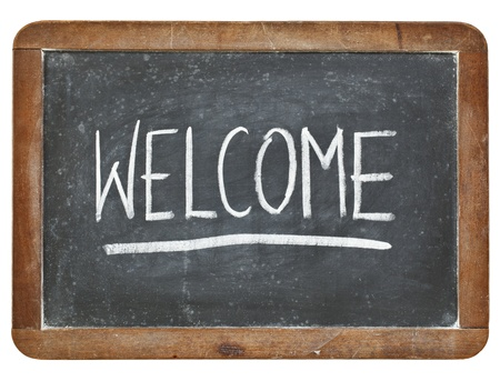 welcome - white chalk handwriting on isolated vintage slate blackboard