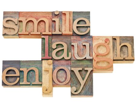 smile, laugh, enjoy - isolated text in vintage letterpress wood type Stock Photo - 12871695