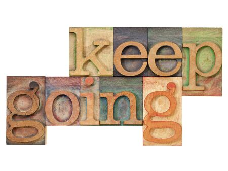 keep going - motivation  concept - isolated text in vintage letterpress wood type Stock Photo - 12980890