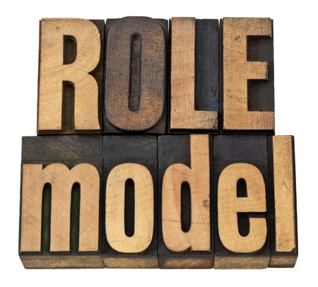 role models: role model -  leadership concept - isolated phrase in  vintage letterpress  wood type