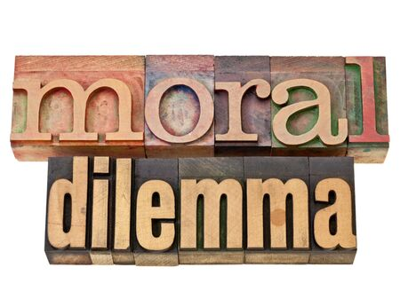 dilemma: moral dilemma - ethics concept - isolated text in vintage letterpress wood type Stock Photo