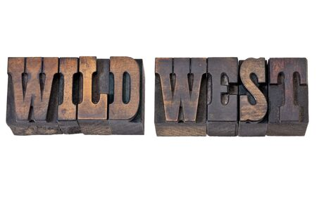 wild west - isolated text in vintage letterpress wood type - French Clarendon font popular in western movies and memorabilia Stock Photo - 13085560