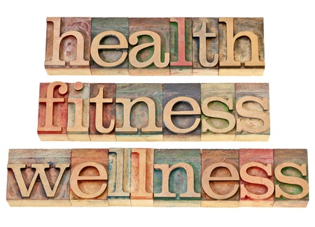 health, fitness, wellness - healthy lifestyle concept - isolated text in vintage letterpress wood type photo