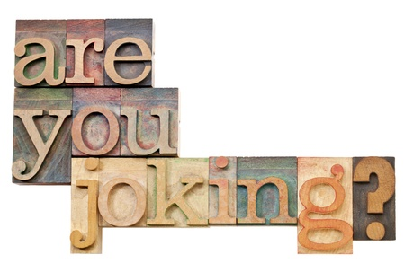 joking: are you joking question - isolated text in vintage letterpress wood type