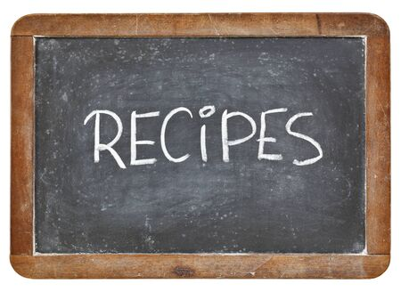 recipes word - white chalk handwriting on a vintage slate blackboard isolated on white photo