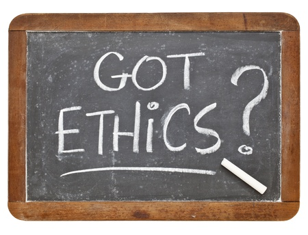 Got ethics question - white chalk handwriting on a vintage slate blackboard, isolated Stock Photo - 13174438