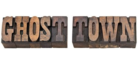 ghost town: ghost town - isolated phrase in vintage letterpress wood type, French Clarendon font popular in western movies and memorabilia
