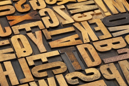 alphabet abstract in vintage letterpress wood type with ink patina Stock Photo - 13222927