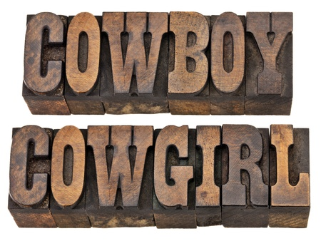 french text: cowboy and cowgirl - isolated words in vintage letterpress wood type, French Clarendon font popular in western movies and memorabilia