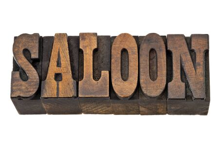 saloon  - isolated word in vintage letterpress wood type, French Clarendon font popular in western movies and memorabilia Archivio Fotografico