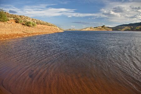 windy mountain lake - Horsetooth Reservoir near Fort Collins, Colorado, summer time before sunset Stock Photo - 13227071