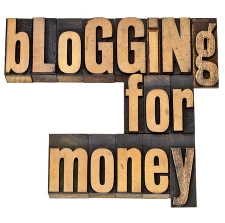 monetizing: blogging for money - internet and entrepreneur concept - isolated phrase in vintage letterpress wood type Stock Photo