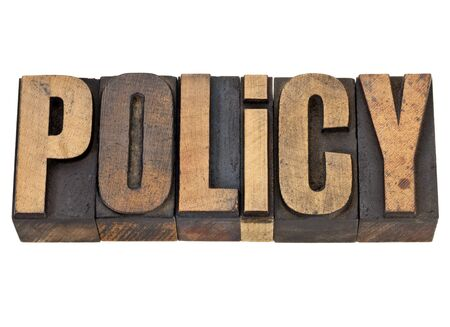 policy  - isolated word in vintage letterpress wood type Imagens