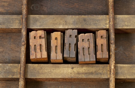 typesetter: ligature - vintage wooden letterpress printing blocks in an old grunge typesetter drawer Stock Photo