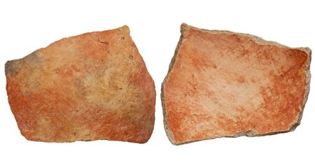 anasazi: Arizona Anasazi pottery shard, ancient Native American Indian artifact, two sides of a large bowl fragment, isolated on white Stock Photo
