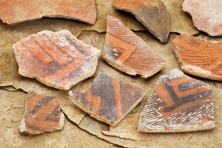 anasazi: Arizona Anasazi pottery shards, ancient Native American Indian artifacts, several fragments of a bowl,  on a sandstone background