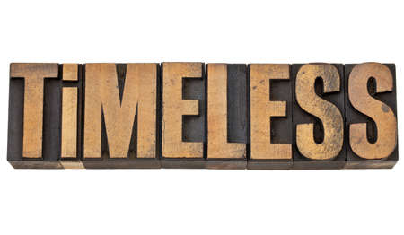 timeless - isolated text in vintage letterpress wood type Stock Photo - 13378890