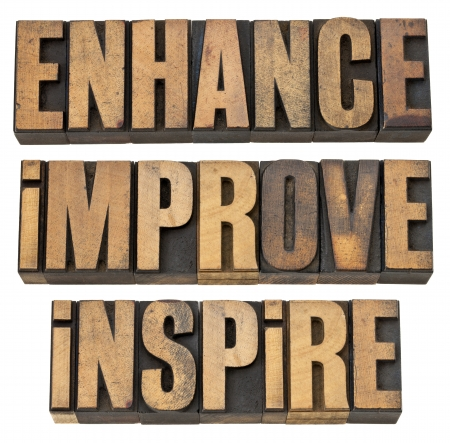 letterpress words: enhance, improve, inspire - a collage of isolated motivational word in vintage letterpress wood type