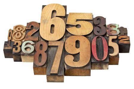 number abstract - vintage  letterpress wood type stained by color inks, a mix of fonts Stock Photo - 13378894