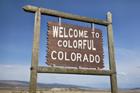 welcome to Colorado roadside wooden sign at a border with Utah in northwestern Colorado