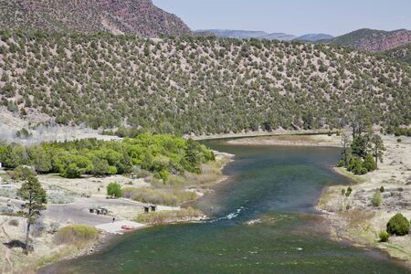 Green River at Little Hole, Utah, below Flaming Gorge Dam, boat ramp with a raft and fisherman, spring with fresh green colors