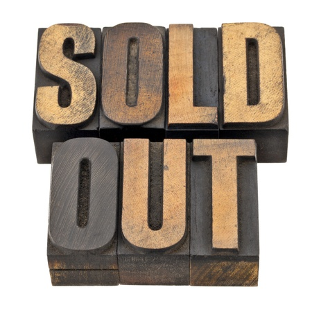 sold out  - business concept - isolated text in vintage letterpress wood type Stock Photo - 13559125