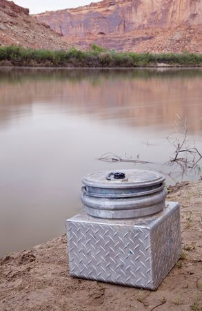 small metal portable toilet on a shore of Green River, equipment required on river trips in Canyonlands, Utah Stock Photo - 13559135